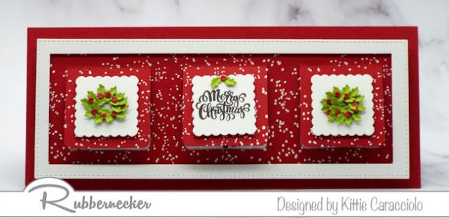 The outside of a slimline peek a boo Christmas card featuring die cut details such as tiny pieced wreaths on the front and an assortment of snowmen in each window