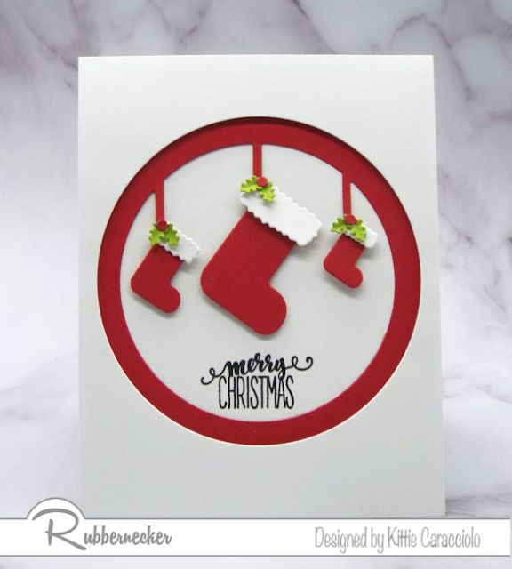 A simple handmade Christmas card made using the Stockings in Circle cut with red cardstock pops against the white background.