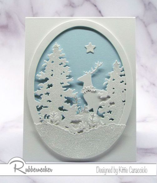 A stunning card based on my white on white Christmas card idea showing a wintry scene made from die cuts inside a die cut window