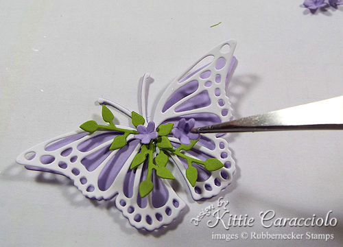 Decorate die cut butterflies with tiny flowers and stems to make simple handmade cards more special.