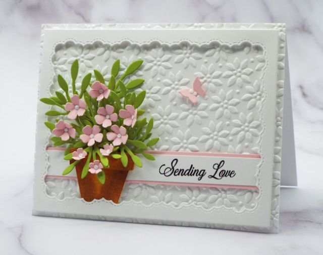 Using a grouping of tiny paper flowers like these bitty pink blossoms on greenery in a flowerpot can have loads of impact on your hand made cards