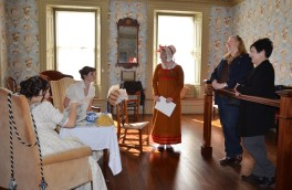 Visitors from New York meet the ladies and mantua maker