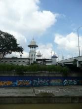 Modern building alongside river graffiti