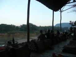 Lounging at Utopia, right on the river - watching the sunset