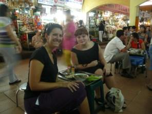 Dominika and I at the market on mini stools
