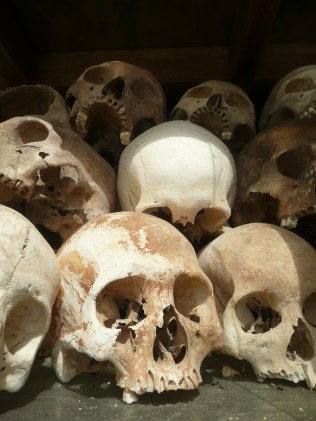 Skulls of those lost at the killing fields, sobering day