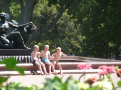 Little boys playing in the fountain