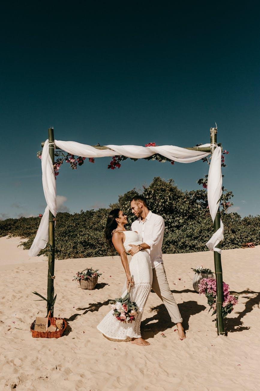 bride and groom on sand beach