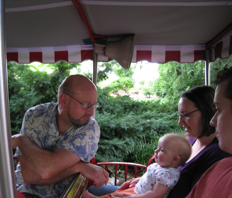 grandpa entertaining kivrin on the train