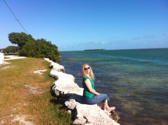 Debbie dipping her feet at one of the islands on the Keys