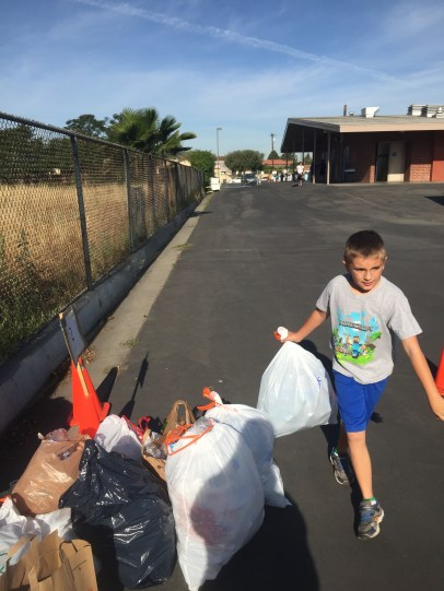 Elementary school students from Carver Academy in Cerritos collect recyclables for Earth Day.