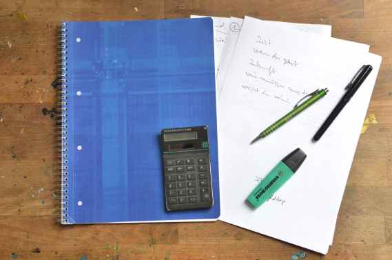 office supplies and notebook on desk