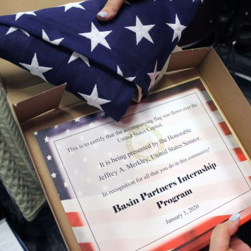 U.S. Sen. Jeff Merkley honored the Basin Partners Internship Program with an American flag that flew over the U.S. Capitol and a certificate for making a positive difference in its community.