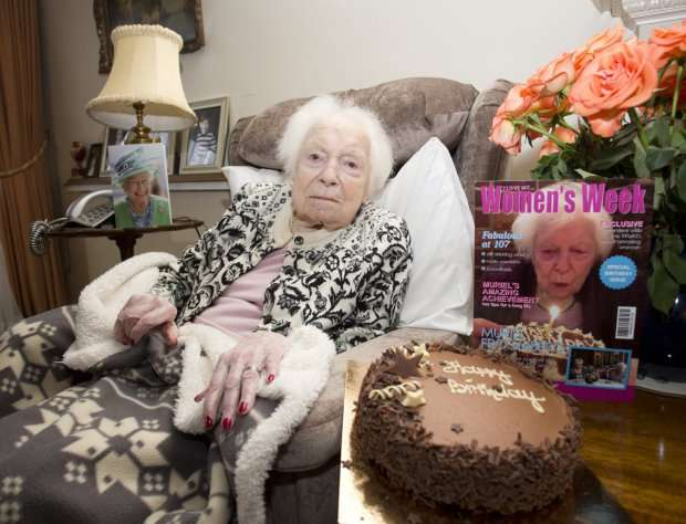 """Great grandmother Muriel Froomberg, 107, likes to enjoy a bottle of whisky once a week mixed with ginger ale at her home in St John's Wood, north London. She stopped smoking at the age of 102 because she wanted to see her great-great grandchildren grow. See SWNS story SWFAGS: A woman who turned 107 says her secret to long life is giving up smoking aged 102 - but still has a secret stash of 800 fags in her room. Muriel Froomberg quit ciggies five years ago so she could """"live a long life"""" and watch her great great grandchildren grow up. She packed in the fags at the tender age of 102 - after more than ninety years smoking around 40-a-day - and hasn't looked back. But canny great great granny Muriel has even got 800 cigarettes stashed in her bedroom that she's saving in case she might need them."""