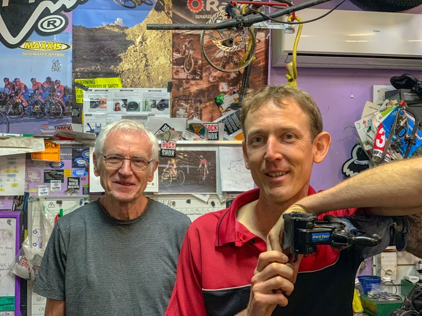 group image of john and erik in the bike shop work area