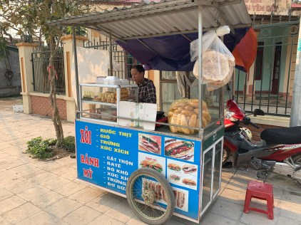 A street vendor selling banh mi, the Vietnamese sandwich