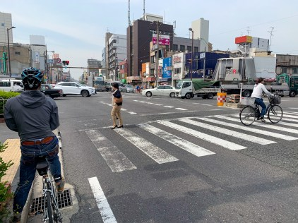 Following behind a speedy Japanese cyclist out of the busy Osaka Metro Area.