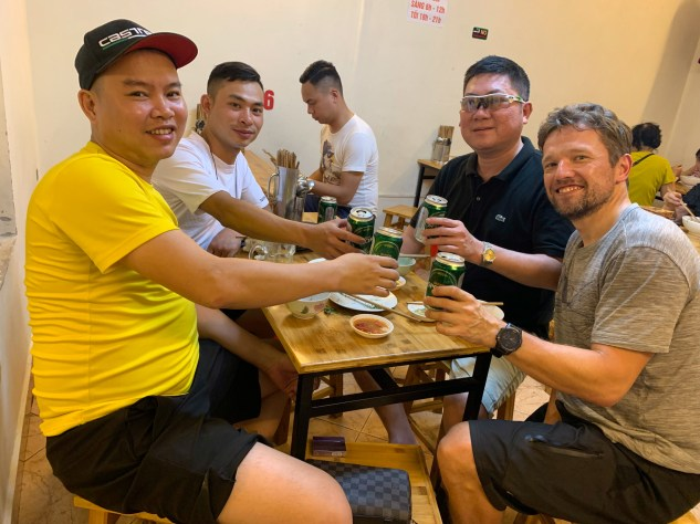 Back in Hanoi, I encountered local road bikers at a pho place across the street.