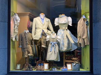 """Display window in the center of Kitzbühel, showcasing traditional regional garments (""""Tracht"""")"""