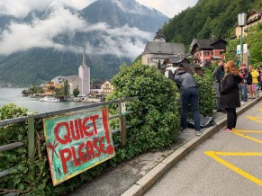 A sign reminds tourists that Hallstatt is not an open-air museum and respect its residents