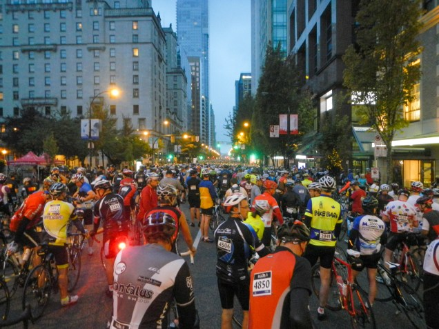 Sea of riders waiting along Georgia Street in Downtown Vancouver