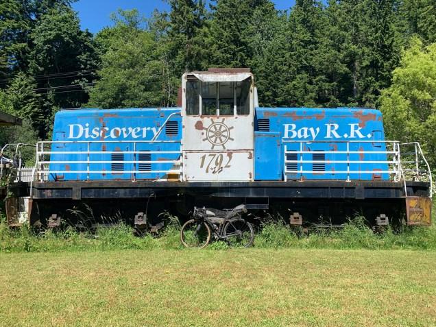 bike leaning against decommissioned railway car