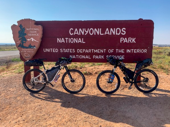 Our two montain bikes leaned against the entry sign of Canyonlands National Park