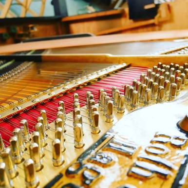 """New strings on an """" Roth und Junius"""" Upright Piano #pianorenovation #instagold"""