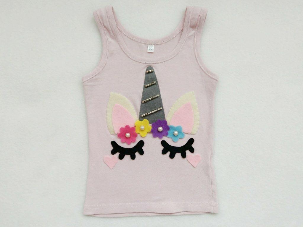 Ein Einhorn Kostüm für Kinder selber machen ist nicht schwer und geht ganz ohne Nähmaschine. Hier zeige ich euch wie ihr ein Einhorn Top selber machen könnt.