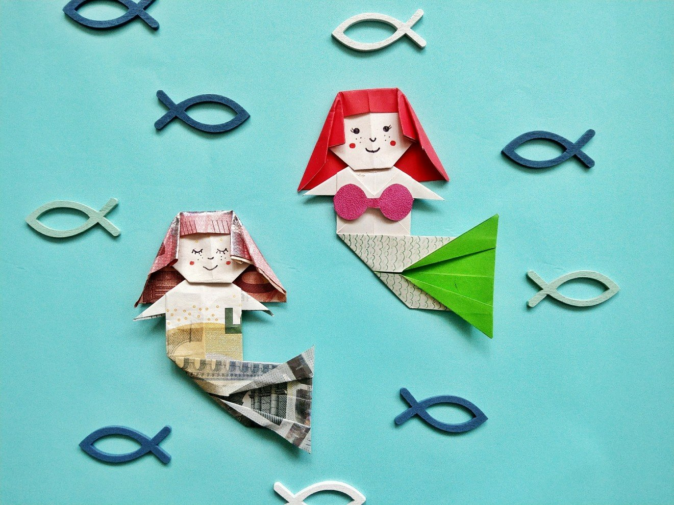 You are currently viewing Origami Meerjungfrau falten – originelles Geldgeschenk zum Falten