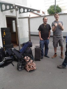 Fin and Daniel stand next to the pile of gear.
