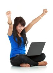 Happy and lucky young woman with laptop