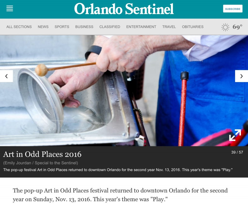 """a photo in the Orlando Sentinel Newspaper of klimchak performing """"When You Whistle, It's Not Work"""". He is playing a pan lid while lowering it into water to change the pitch,"""