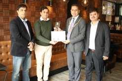 Chaudhry zulfiqar receiving community services award from Rana Naveed Chairman of Parish Council Colnbrook