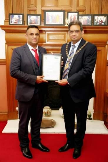 UKPBC SVP Asim Yousaf receiving appreciation certificate from Mayor of Ealing Munir Ahmed