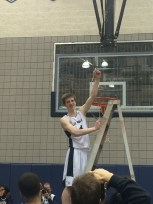 Grant Mitchell cutting the net after a great performancwe and getting the win.