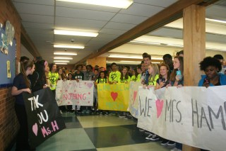 All the students in third lunch students gathered to surprise Jacqueline Hampton in the cafeteria. They were all eager to see her reaction to the surprise. Photo Credit / Audra Penny