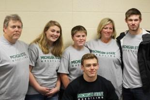 Nick May poses for a picture with the rest of the May family. He is the second oldest in a family of four, and the first to go to Michigan State. Photo Credit / Chris Hybels