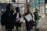 Sophomore Victor Moss, freshman Karis Clark, English teacher Paige O'Shea, and staff member Jay Gross protesting for the reduction of standardized tests. All three were in attendance at the walk-in. Photocredit / Christian Baker