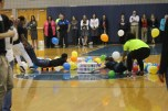 """Juniors Lauren Cole and Ashantai Hale-Sandifer compete during the balloon game at the Spring Pep Rally. """"This game made me so dizzy, but I had a lot of fun though,"""" said Cole."""
