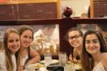 Aude Kuzniak, Lusia Stock, Brooke Washington, and Julia Morera smile for the camera. Photo Credit / Abby Farrer