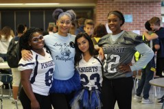 """FRIDAY: Seniors Destiny Mabon, Ashantai Sandifer, Jasminmarie Castaneda, and Morgan Hawkins dressed in blue and white. """"Got to go all out, let's get it,"""" exclaimed Sandifer. Photo Credit / Hannah Pittman"""