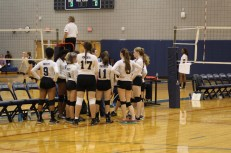 The Freshman volleybal team huddles during a timeout from their game against Mattawan. Photo Credit / Sidney Richardson