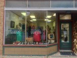 """Handmade Kalamazoo showing off one of their best selling """"Mad Love"""" shirts along with many other one of a kind peices of art in the display window. / Photo Credit Joshua Wild"""