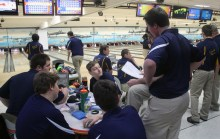 The bowling team listens intently to junior Trevor Morgan and coach Mike Brandt's gameplan. The team finished their season with only one loss. Photo Credit / Joey Welch