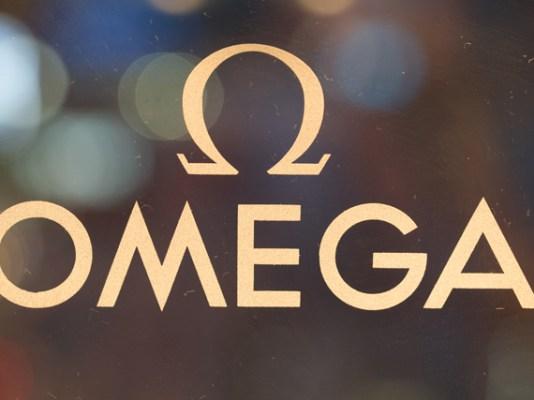 Logo Omega color beige