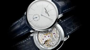 Reloj Vacheron Constantin con correas azules de piel y caratula plateada con dial blanco visto de frente y por detrás