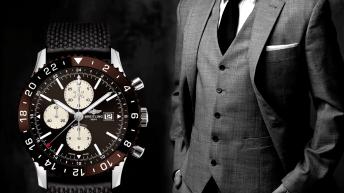 Portada con un hombre de traje y un reloj en tono café Breitling