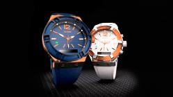 Reloj azul y reloj blanco con detalles en color naranja