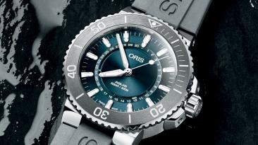Reloj de la fuente de la vida gris con verde